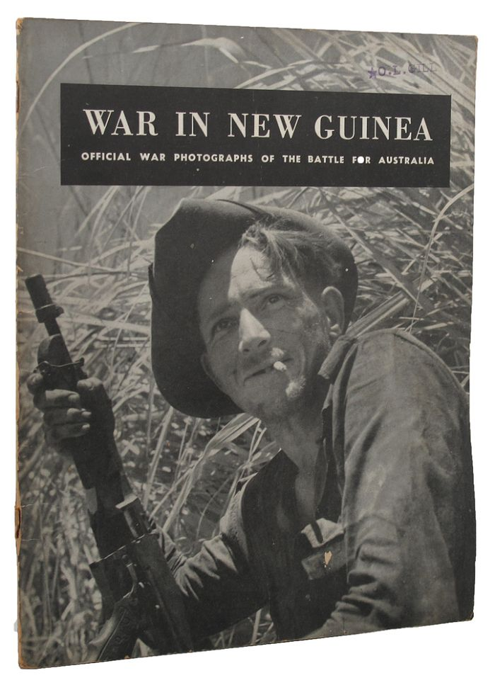 WAR IN NEW GUINEA: official war photographs of the battle for Australia [cover title]. Australian Commonweath Department of Information, George Silk, Photographer.