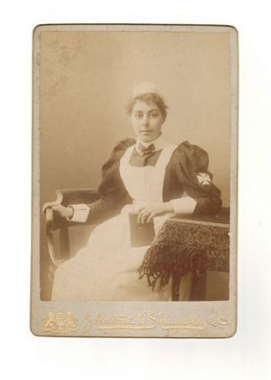 19th CENTURY STUDIO PHOTOGRAPH OF UNIDENTIFIED WOMAN IN NURSE'S UNIFORM. O'Shannessy Johnstone,...